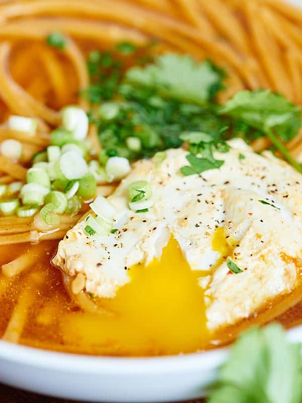 closeup of egg in bowl of asian noodle soup