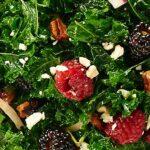 This Balsamic Kale Salad Recipe is quick & easy, so healthy, & full of creamy feta, toasty pecans, & tart berries. All smothered in a balsamic vinaigrette. showmetheyummy.com #kalesalad #balsamicvinaigrette