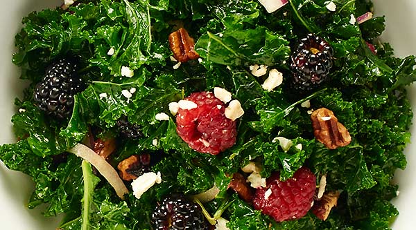 This Balsamic Kale Salad Recipe is quick & easy, so healthy, & full of creamy feta, toasty pecans, & tart berries. All smothered in a balsamic vinaigrette. showmetheyummy.com #kalesalad #balsamicvinaigrette