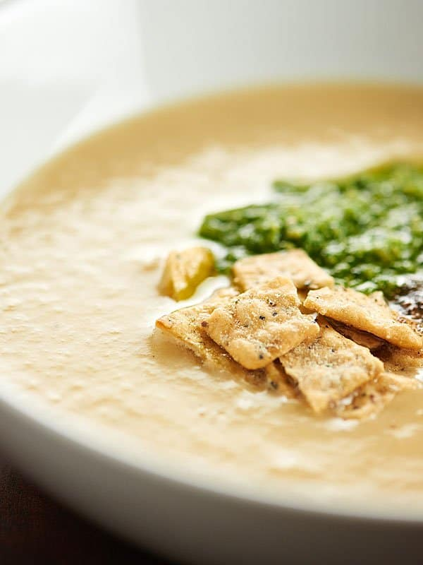A lightened up version of potato leek soup, this Cauliflower Leek Soup Recipe is made in the crockpot, has about 100 calories per cup, and is so cozy! showmetheyummy.com #crockpot #cauliflower