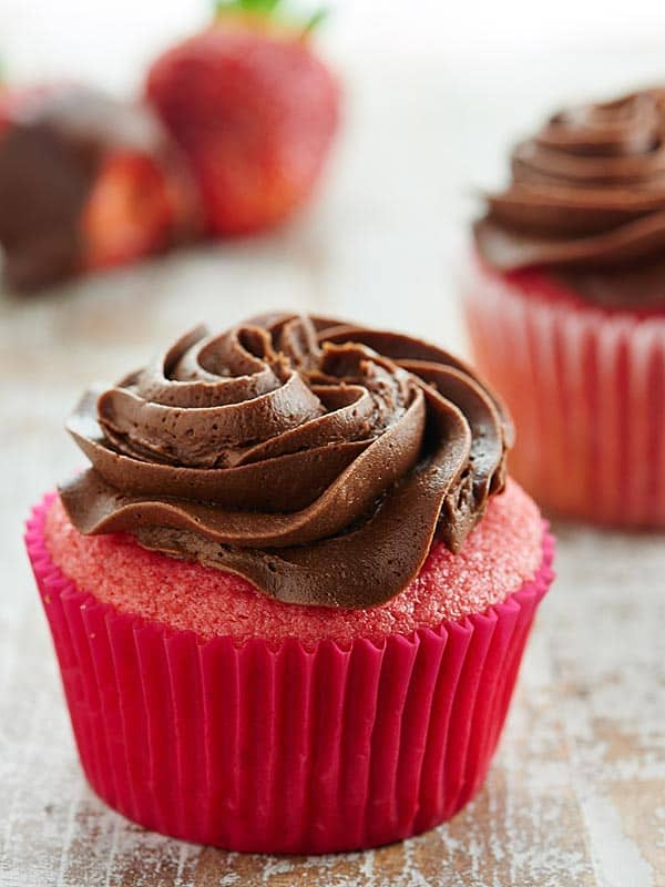 This Chocolate Strawberry Cupcakes Recipe is a twist on chocolate covered strawberries. A moist, strawberry cupcake is smothered in the creamiest chocolate buttercream! showmetheyummy.com #strawberrycupcake #chocolatebuttercream
