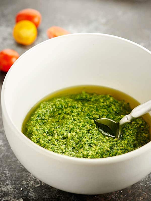 Cilantro pesto in a bowl with spoon