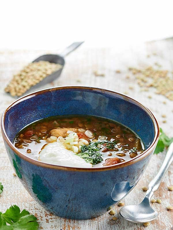How about a steaming hot bowl of Slow Cooker Chicken Lentil Soup on a chilly day? This soup is easy, healthy, and has less than 350 calories per serving! showmetheyummy.com #slowcooker #chickenlentilsoup