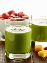 An easy, healthy, tasty tropical green smoothie recipe that's loaded with good for you ingredients like kale, mango, and strawberries! It's gluten free, can be vegan, and only takes 5 minutes to whip up! showmetheyummy.com #greensmoothie #healthy