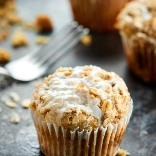 These Coffee Cake Muffins are perfectly cinnamon-y, fluffy, tender, moist, are stuffed with a brown sugar, cinnamon filling, & topped with a crunchy streusel! showmetheyummy.com #muffins #coffeecake