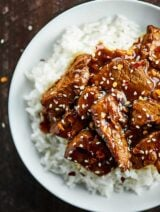 After marinating, this Easy Mongolian Beef Recipe takes less than 30 minutes to make! This Mongolian Beef is easy & so flavorful. No frying required! showmetheyummy.com #mongolianbeef #flanksteak
