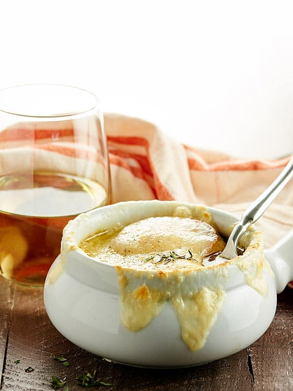 This French Onion Soup Recipe is the perfect appetizer for two! A flavorful beef and onion broth is topped with baguette, parmesan, and gooey swiss cheese! showmetheyummy.com #frenchonionsoup #appetizer
