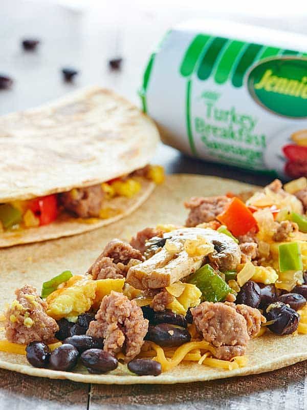 This Sausage Breakfast Quesadilla Recipe is healthy, easy, freezer friendly, can be made in advance, & is full of lean turkey sausage and plenty of veggies! showmetheyummy.com #spon #jennieo @jennieorecipes