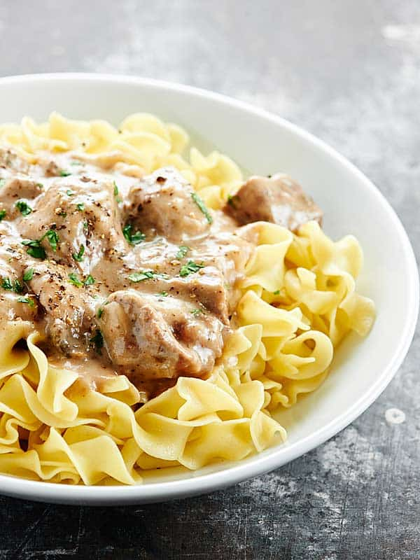 """Love beef stroganoff? You'll love my Slow Cooker Beef Stroganoff! It's made in the crockpot, has no """"cream of x"""" soup, & uses my blend of spices! showmetheyummy.com #slowcooker #beefstroganoff"""