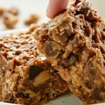 These Vegan Granola Bars are dessert bars made out of granola & full of crunchy textures, great peanut butter flavor, & naturally sweetened w/ maple syrup! showmetheyummy.com #vegandesserts #granolabars