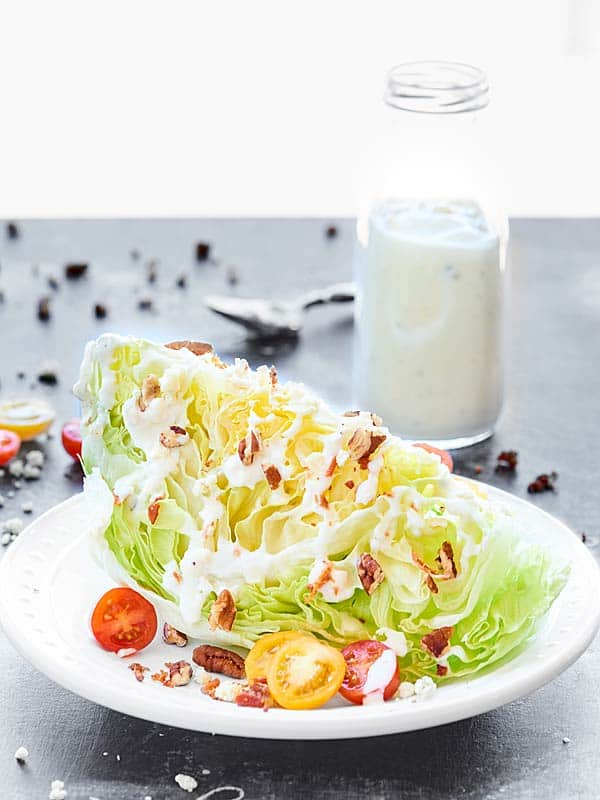 This Greek Yogurt Blue Cheese Dressing is made with 5 ingredients, and is packed with protein, plenty of blue cheese, and is ultra creamy without the guilt! showmetheyummy.com #greekyogurt #bluecheesedressing