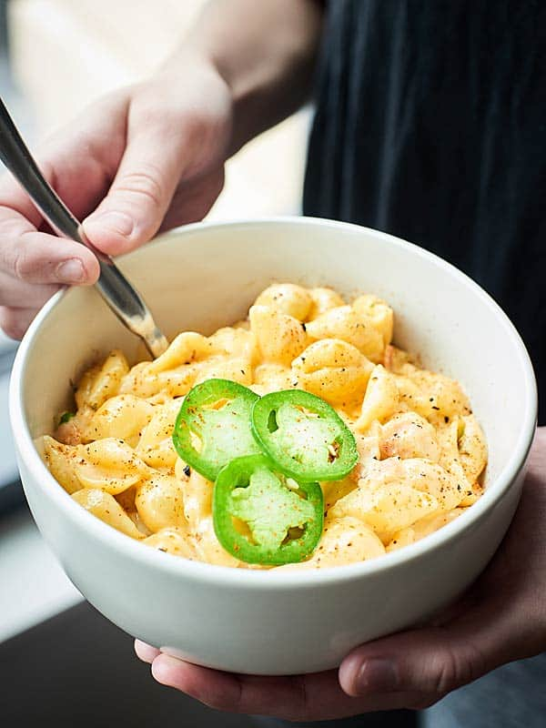 bowl of jalapeno popper mac and cheese held