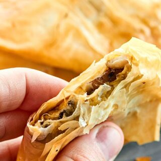 These Mushroom Puffs are SO simple and elegant. The mushroom filling is so creamy, spicy & the phyllo pastry is warm, flakey, & melt in your mouth buttery. showmetheyummy.com #ad #BoursinParty #Walmart @Walmart @Boursin