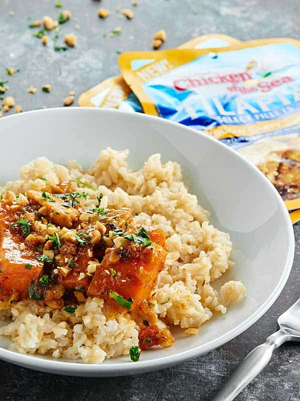 A twist on a Thai curry, this Roasted Red Chili Tilapia Recipe is full of yellow curry tilapia, roasted red chili paste, sweet potatoes, and coconut milk. showmetheyummy.com #SeaThePossibilities #spon @chickenofthesea