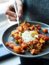 This Sweet Potato Hash Recipe is perfect for brunch! Full of bacon, eggs, sweet potatoes, cheese, & spices, this breakfast hash is filling, easy, & yummy! showmetheyummy.com @Crystal_Farms #CrystalFarmsCheese #ad