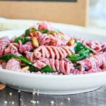 This Beet Pasta Recipe is perfect for spring! Made with fresh beet pasta, lemon juice, a touch of olive oil, arugula, goat cheese, and toasted pine nuts, this pasta is easy, fresh, and delicious! showmetheyummy.com #pasta #vegetarian #pastacrate #ad