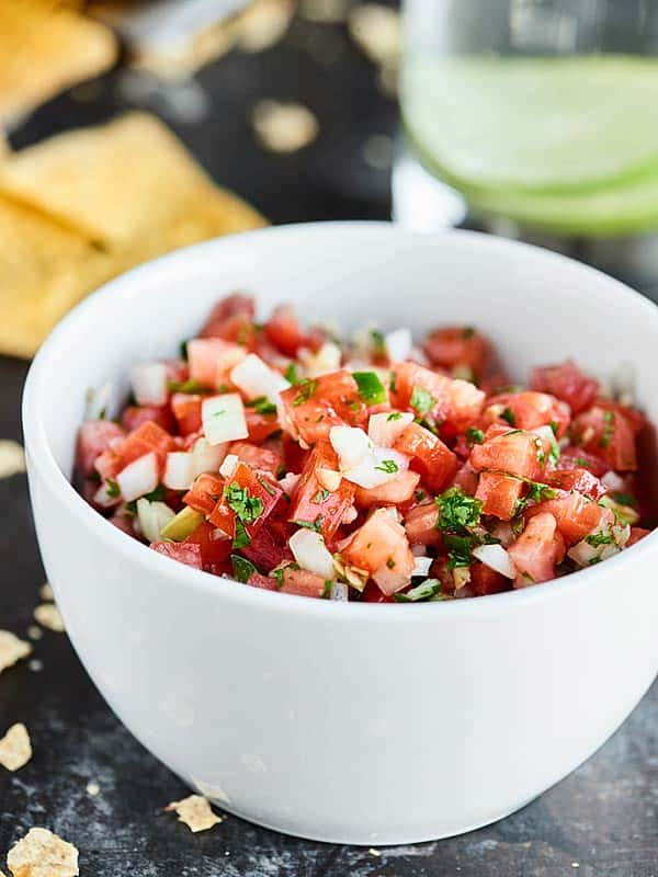 This Easy Pico de Gallo Recipe comes together in a matter of minutes! Fresh tomatoes, onion, cilantro, jalapeno, lime, & garlic make this truly delicious. showmetheyummy.com #picodegallo #healthymexicanfood