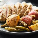 Baked pork tenderloin at it's finest! This Lemon Herb Pork Tenderloin Recipe is healthy, easy, & full of fresh spring flavors like lemon, dijon, & garlic! showmetheyummy.com #porktenderloin #springrecipe