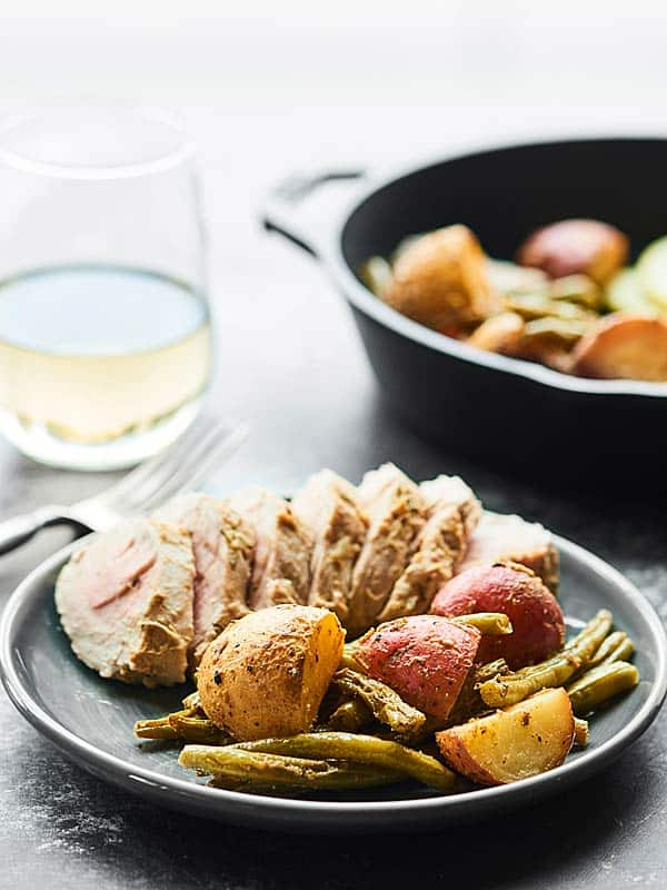 Baked pork tenderloin at it's finest! This Lemon Herb Pork Tenderloin Recipe is healthy, easy, & full of fresh spring flavors like lemon, dijon, & garlic! showmetheyummy.com #porktenderloin #springrecipe