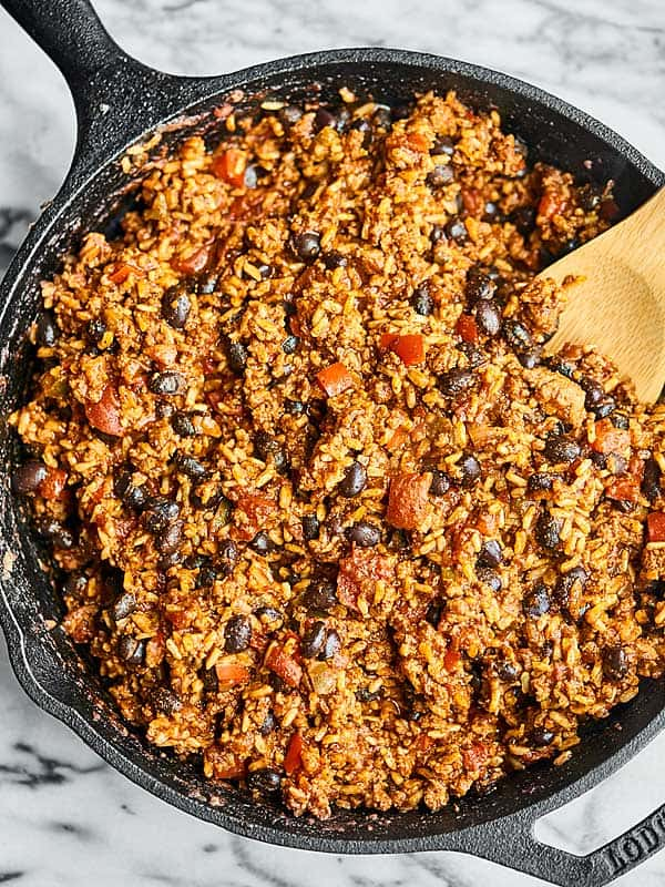 A simple, hearty, yet lightened up meal, this cheesy one pan wonder Mexican Skillet is so easy and full of ground turkey, vegetables, and plenty of cheese! showmetheyummy.com #ad #mexicanfood @sargentocheese