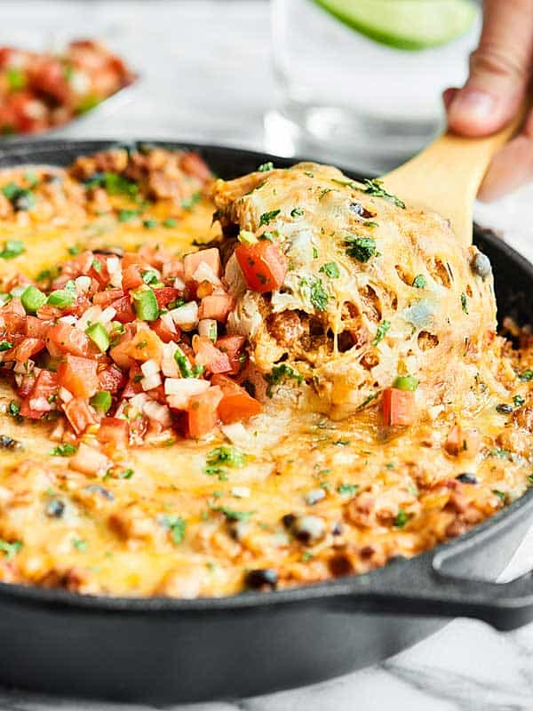 spoonful being scooped out of mexican skillet