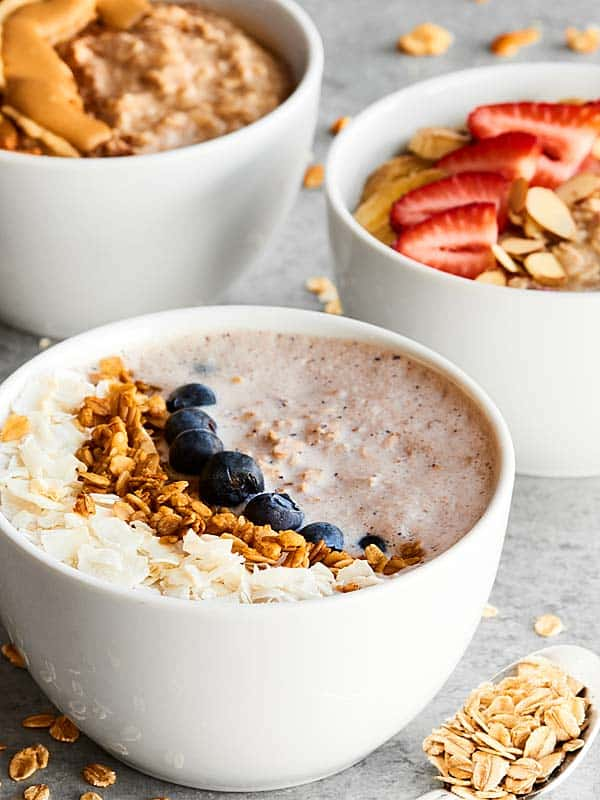 Overnight Oats Recipe 3 Ways! 1. Peanut Butter Honey Banana 2. Blueberry Greek Yogurt (no banana) 3. Vegan Strawberry Banana. All healthy, easy & delicious! showmetheyummy.com #overnightoats #healthybreakfastrecipe