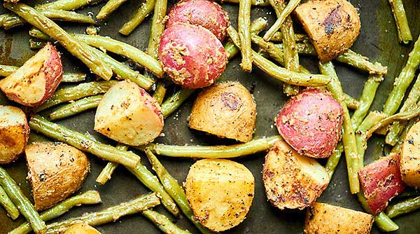 This Roasted Potatoes and Green Beans Recipe is my new, go-to spring side dish! Potatoes are paired w/ green beans & smothered in a lemon mustard dressing. showmetheyummy.com #roastedpotatoes #greenbeans