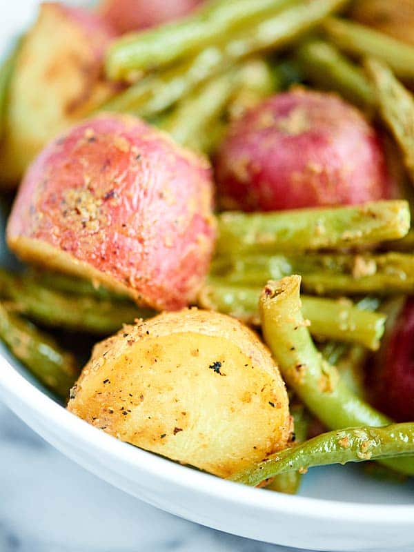 Closeup of roasted potatoes and green beans