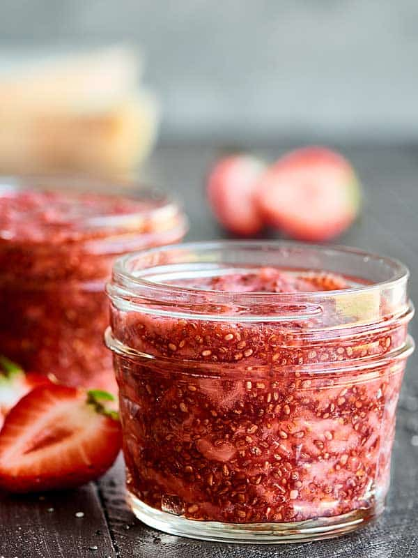 Only 5 ingredients are needed to make this Strawberry Chia Jam. It's vegan, gluten free, easy to make, pretty darn healthy, and helllooo is ultra delicious! showmetheyummy.com #chiajam #strawberryjam