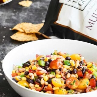 Ready for the easiest Cinco de Mayo recipe? This Texas Caviar comes together in a matter of minutes and is full of fresh veggies - peppers, onion, tomatoes - beans, corn, and a tangy dressing! showmetheyummy.com #texascaviar #cincodemayo