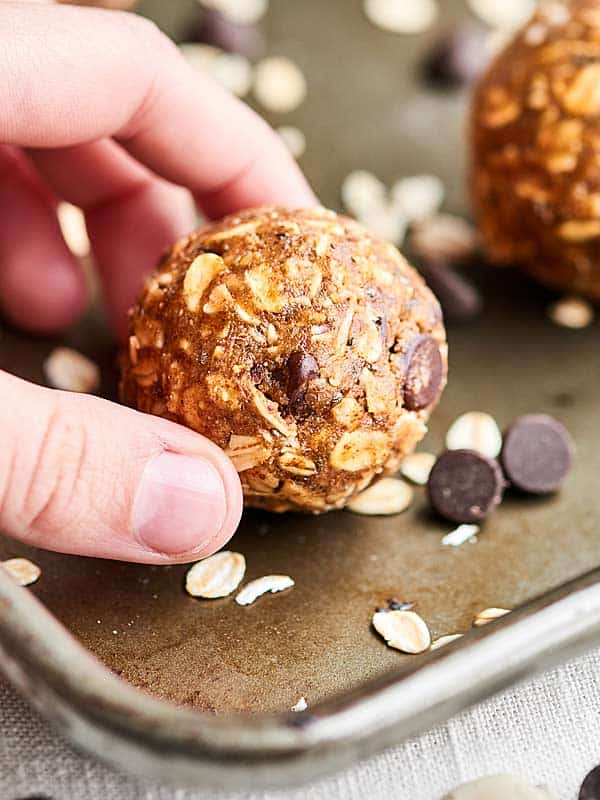 These Almond Butter Energy Bites are SO healthy and delish. They're nutty and rich from the almond butter, chewy from the oats, and sweet from the maple syrup and dark chocolate chips! showmetheyummy.com #almondbutter #energybites