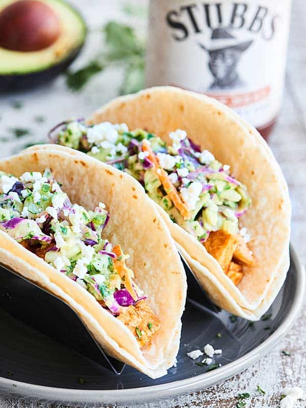 Juicy grilled chicken smothered in BBQ sauce plus crunchy, fresh, healthy coleslaw makes these the easiest & tastiest Grilled BBQ Chicken Tacos ever! showmetheyummy.com #ad #stubbsinsider @stubbsbbq