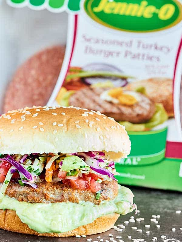 These are the BEST Mexican Turkey Burgers. Tender turkey burgers, crunchy slaw, fresh pico, & an avocado sauce make these great for an easy, healthy dinner! showmetheyummy.com #ad #jennieo @jennieorecipes