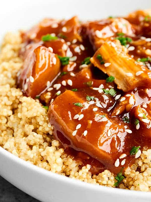 closeup of chicken over quinoa with sesame seeds
