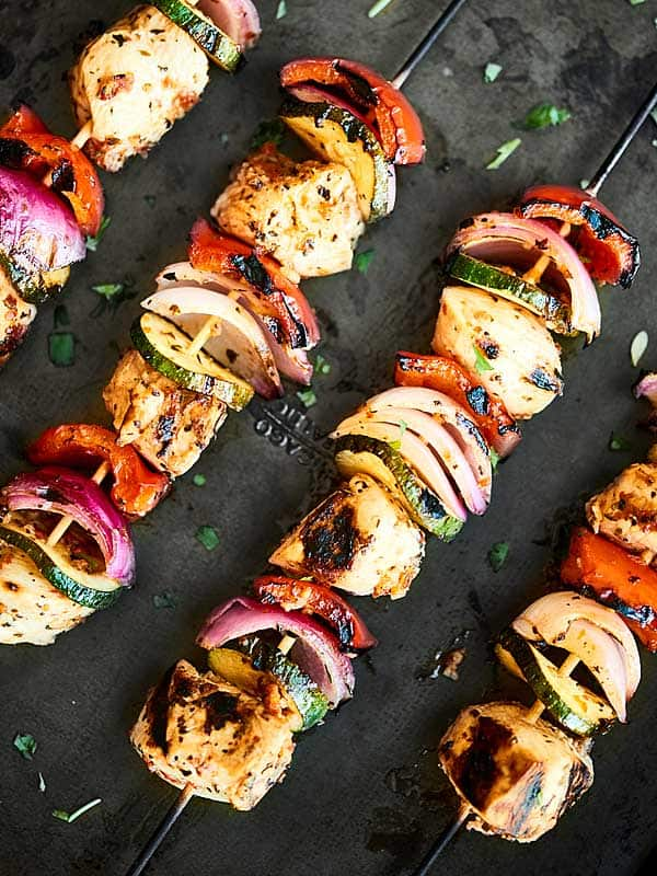 Paired with tzatziki and full of tender chicken, veggies, and an herb-y garlic marinade, these Greek Kebabs are the perfect, quick & easy, healthy summer dinner! showmetheyummy.com #kebabs #greekchicken