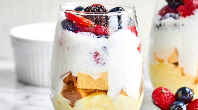 A ridiculously simple dessert, these Lemon Cake Parfaits come together in a matter of minutes and are made with lemon pudding, cool whip, pound cake, and fresh fruit salad! showmetheyummy.com #lemoncake #cakeparfait