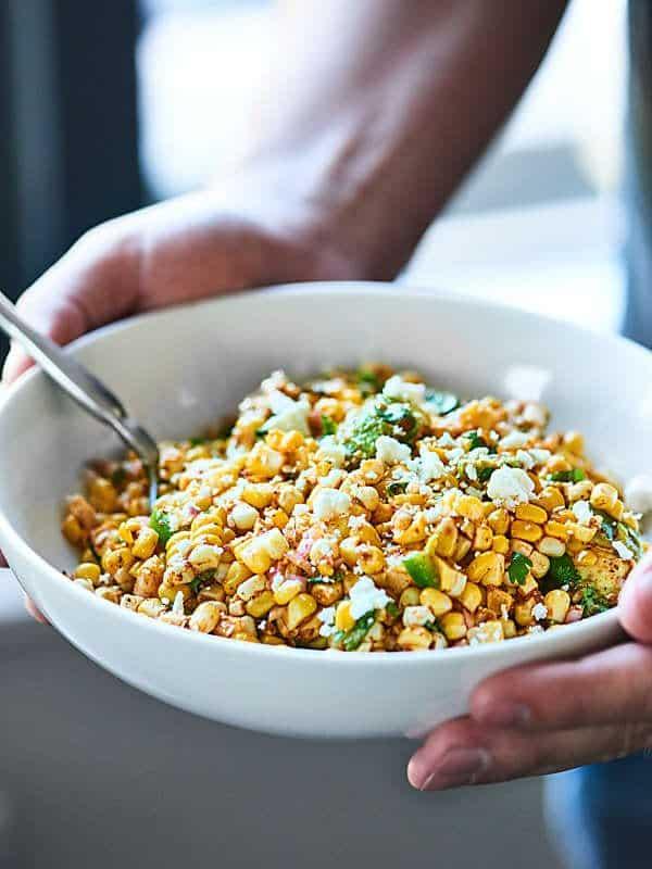 bowl of mexican corn salad held