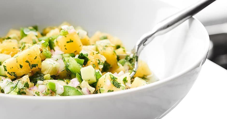 This Pineapple Salsa is full of juicy pineapple, crunchy bell peppers, cooling cucumbers and more to make the perfect sweet, spicy, crunchy salsa ever! showmetheyummy.com #pineapple #salsa