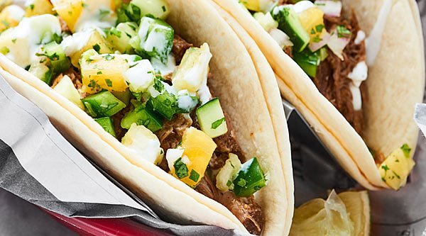 Slow Cooker Carnitas. An easy, flavorful, healthy meal made in the crockpot. Tender pork served in your favorite tortilla and topped with a homemade salsa? Gimme! showmetheyummy.com #porkcarnitas #slowcookercarnitas