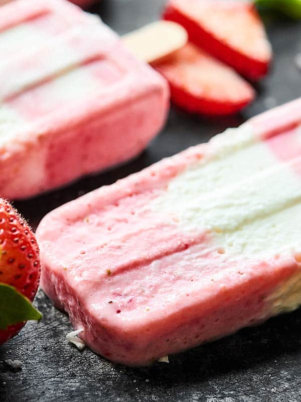 closeup of strawberry coconut popsicles