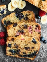 Full of fresh blueberries, raspberries, and dark chocolate chips, this Berry Banana Bread is loaded with goodness and is the perfect breakfast, snack, or dessert! showmetheyummy.com Recipe made in partnership w/ @DriscollsBerry #finestberries #bananabread