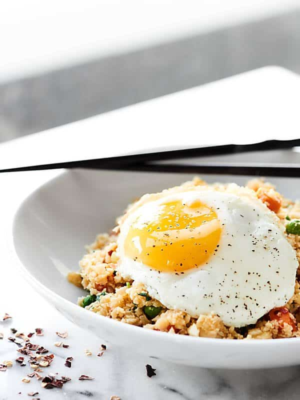 bowl of cauliflower fried rice with fried egg