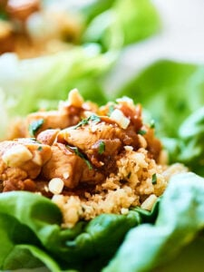 Have a few for a light lunch, or half the recipe for a filling and healthy dinner, these Healthy Asian Lettuce Wraps are full of tender chicken, a crazy flavorful sauce, and loads of texture! showmetheyummy.com #lettucewraps #asianlettucewraps