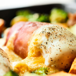 One Pan Cheesy Chicken and Vegetables. Tender chicken breasts wrapped in prosciutto, stuffed with THREE kinds of cheese, and roasted to perfection with broccoli and potatoes. Easy weeknight meal for the win! showmetheyummy.com Recipe made in partnership w/ @WisconsinCheese #WisconsinCheese #chicken