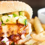 Pork burger with fries and bbq sauce