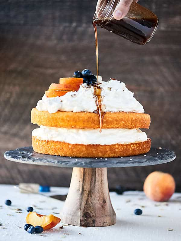 Chardonnay Caramel Cake: a ridiculously easy, flavorful, moist vanilla cake topped with lightly sweetened fluffy whipped cream, and an ultra rich, buttery caramel sauce. Recipe made in partnership w/ @BarefootWine #caramelcake #chardonnay