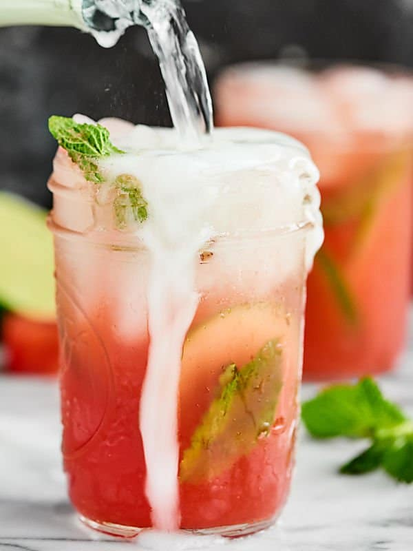 sparkling watermelon mojito in mason jar overflowing