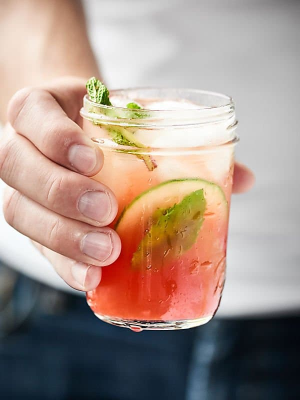 sparkling watermelon mojito held