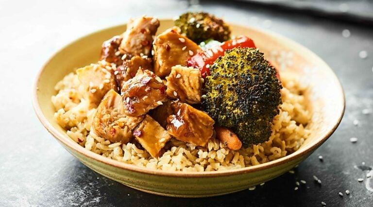 Bowl of teriyaki turkey tenderloin with veggies on brown rice