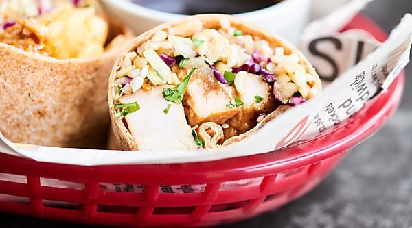 A great use of leftovers, this Teriyaki Turkey Wrap is full of tender turkey, sweet pineapple, crunchy/salty/savory/fresh slaw, earthy brown rice, and a chewy whole wheat tortilla! showmetheyummy.com #turkey #wrap